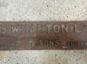 H WHARTON Cast Iron Sign